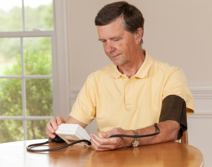 man with blood pressure monitoring device