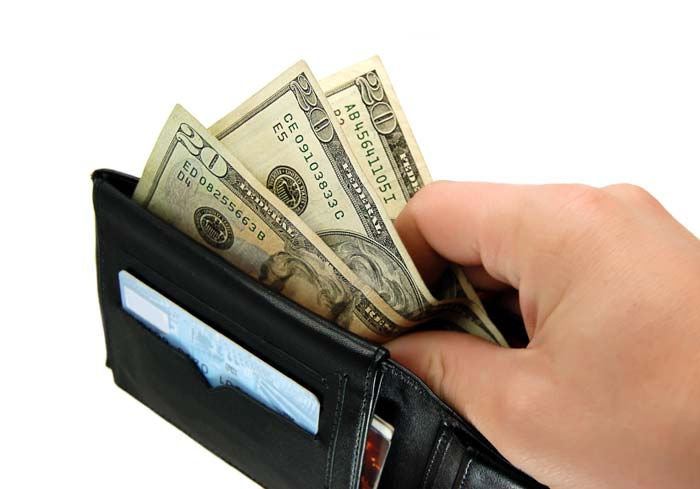 a wallet of money - savings if you quit smoking