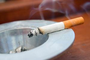 Cigarette on ash tray