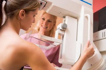 Patient undergoing mammogram