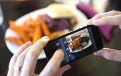 A photo of food being taken with an i-phone