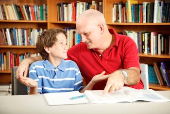 Child reading with help