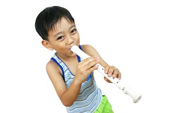 A child playing a recorder