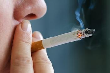 Male smoking a cigarette