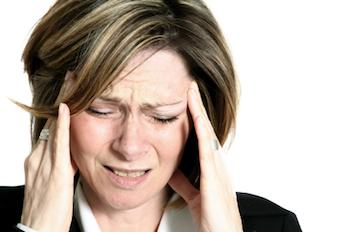Lady with a headache holding her head