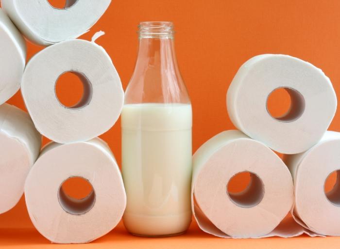 Milk next to toilet paper
