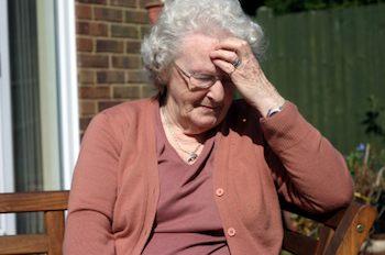 Older lady sitting alone