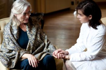 Woman with dementia and carer