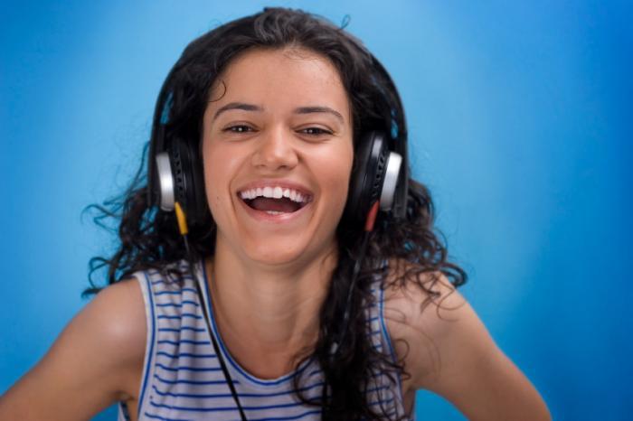 woman enjoying music on headphones