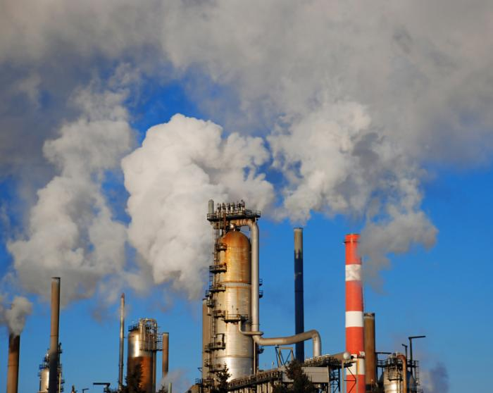 Industrial factory pipes releasing pollution into the air