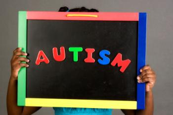 Girl holding autism sign