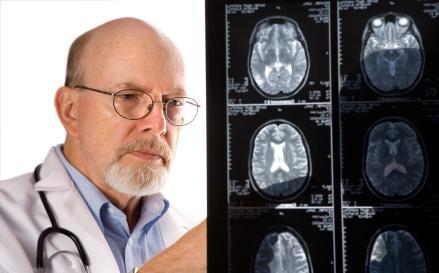 Neurologist inspecting scans