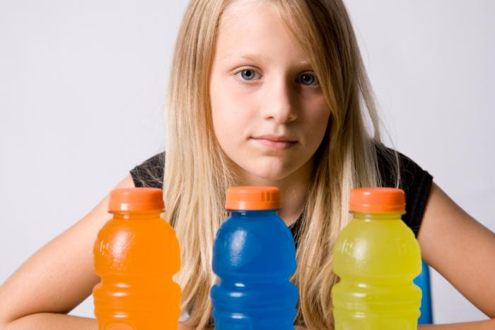 girl with a selection of sports drinks