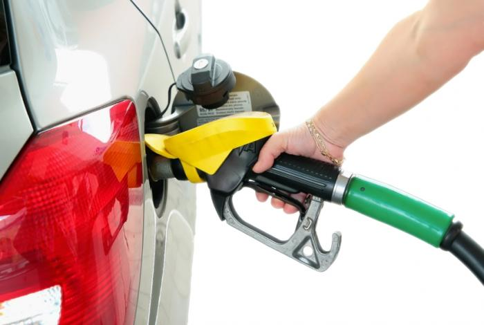 Woman filling up car with gasoline