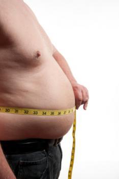 Obese man measuring waist
