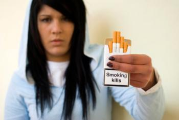 Teenagers holding cigarette packet