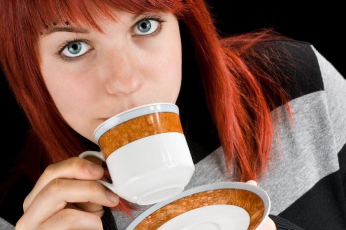 teenage girl drinking coffee