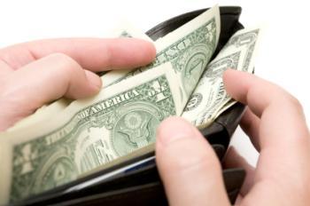 wallet containing dollar bills