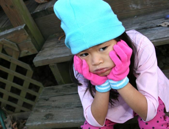 sad child of Asian ethnicity