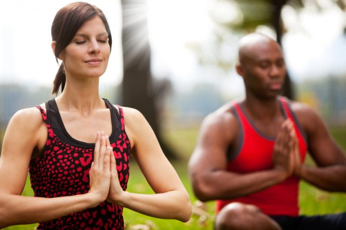 man and woman in a yoga pose