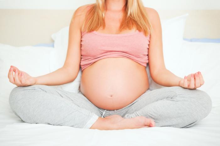 woman taking part in pregnancy yoga