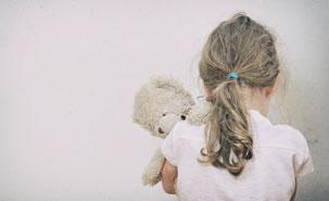 [Young child with soft toy]