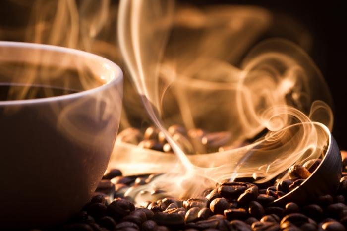 A cup of coffee and coffee beans