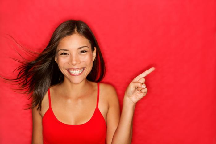 Smiling woman wearing red.