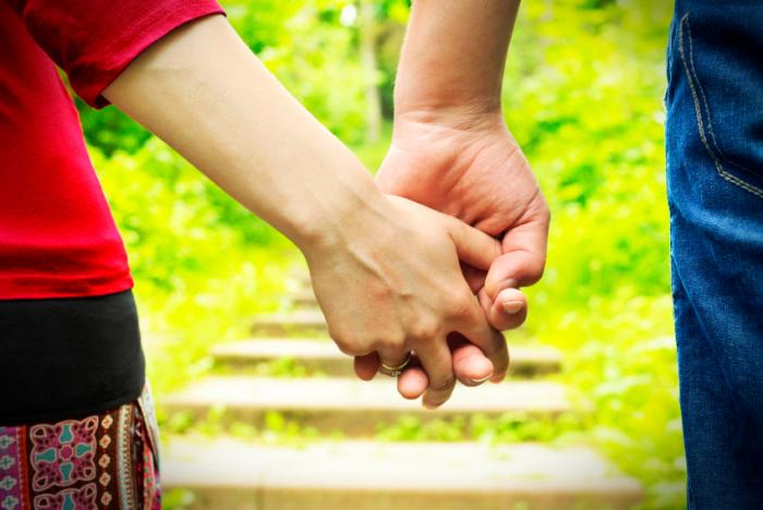 married man and woman holding hands