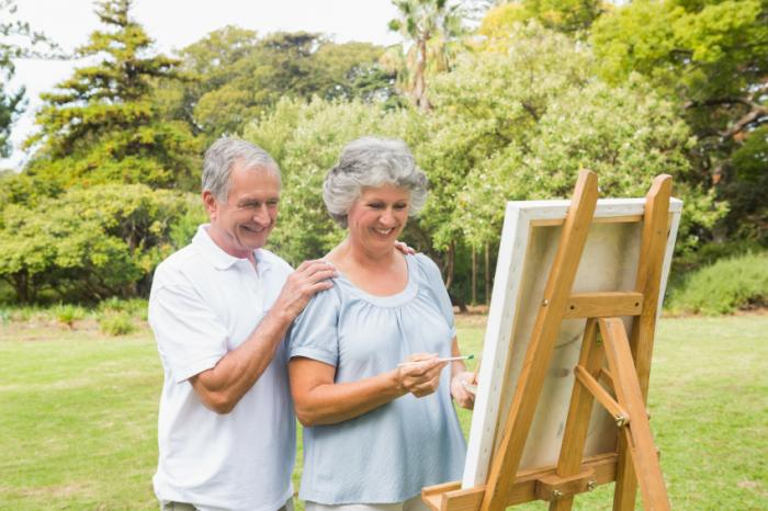 A husband admiring his wife's painting