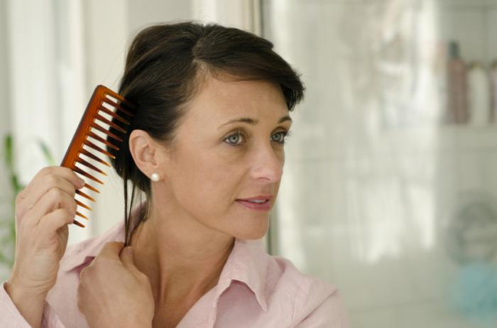 A woman combing her hair