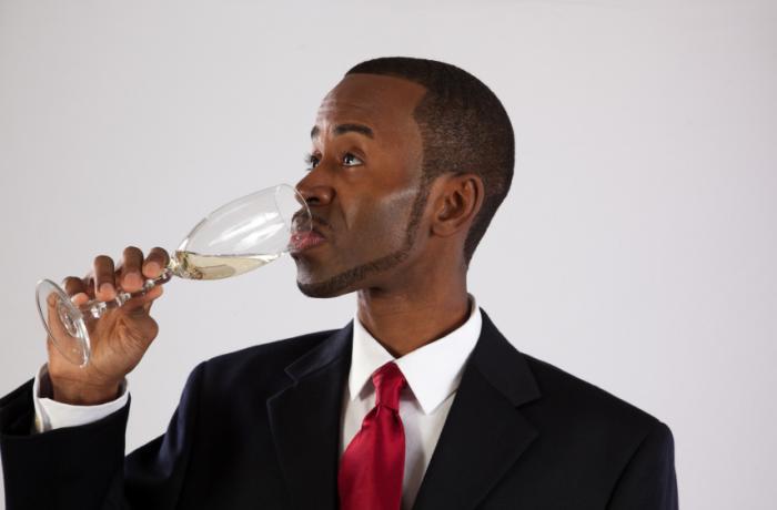 black businessman drinking champagne