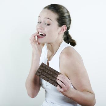 A woman tempted to eat chocolate.