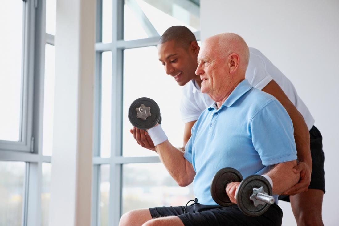 older man using free weights